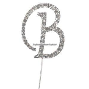 Tårtdekoration med diamanter bokstaven B