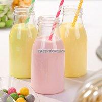 Små mjölkflaskor i plast med lock - 4 st