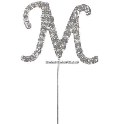 Tårtdekoration med diamanter bokstaven M