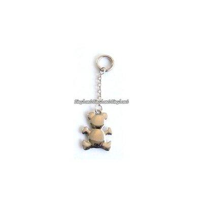 Silverfärgad metall med teddybjörn på nyckelring
